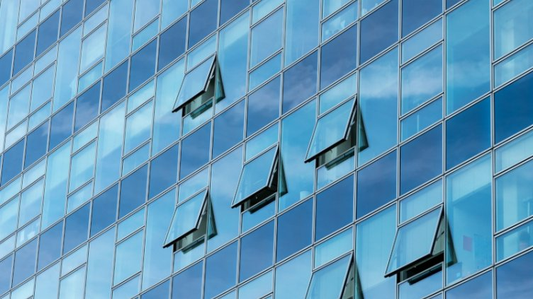 Architectural detail of a modern blue glass skyscraper building with open windows; Shutterstock ID 317097188; PO: GBLMKT/2016-160; project code: GMKT_BRD_3.9.2E; department code: 162800-Global Marketing