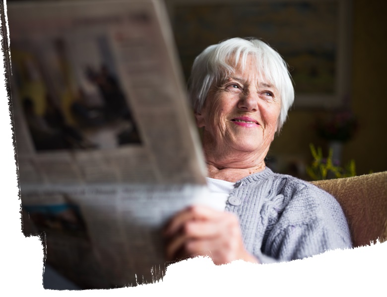 Senior lady reading a newspaper